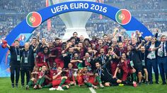 Portugal's players pose with the trophy after they beat France