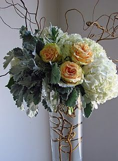 More curly willow, plus hydrangea, roses, dusty miller, and kiwi vine.