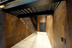 Not quite what we want but shows how a metal stair case could work down to the basement.