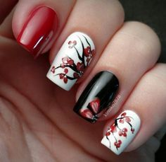 Black red and white nails with red flowers
