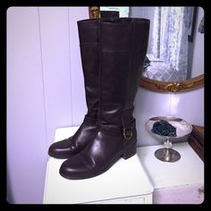 Bandolino  brown leather boots 8 1/2 Riding Tall Chocolate brown colored boots by Bandolino. They are size 8 1/2. They have a small bit of a heel, but nothing major. They have a cute little buckle at the sides. They are made of 100% genuine leather. They are in Very nice condition, they only look like they been worn a few times. The calf measures 16 in around the top of the boot.  The heel is 1 1/2 in tall Bandolino Shoes Heeled Boots