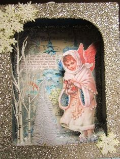 beautiful Christmas shadow box. My cats would be dying to know what's behind that angel!