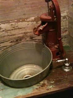 Awesome functional vintage bathroom sink (at Texas Antique Week). Turn the chrome handle and water comes out the old pump!