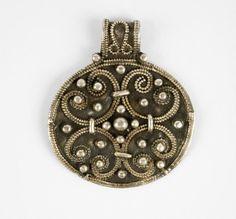 Slavic pendant adorned with lunula ornaments.