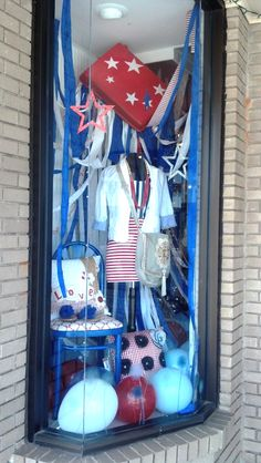 4th of July Window display by Maggie Overby Studios at theThe Dandy Lion Boutique