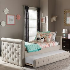 With its intricate and refined delicacy, the Swamson fabric daybed with roll-out trundle guest bed will be an elegant and yet classic piece in your child's bedroom. Upholstered in grey polyester fabri