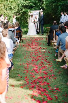 flower petal lined aisle, photo by Jeffrey C. Gleason Photography http://ruffledblog.com/natural-romantic-wedding-with-macrame-details #weddingceremony #ceremonies