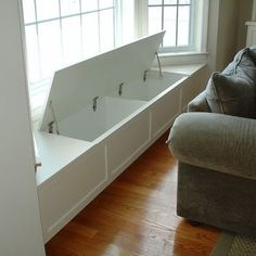 Window seat with storage - good idea for the bay in the dining room. I can store all the table cloths, napkins, place mats, etc, there! Add cushions for seating in the meantime. In a old wood instead of white.