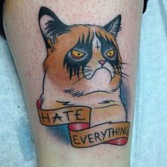 """Likes.com Grumpy Cat Forever   When Grumpy Cat's owner's brother posted a photo of the cat pulling a grumpy expression on reddit back in 2012, we bet he didn't expect the cat to end up tattooed on someone's leg. We also bet he didn't expect Grumpy Cat to star in her own documentary, appear on Good Morning America, be """"interviewed"""" for Forbes or get a book publishing deal…It's Grumpy Cat's world, we're just living in it."""