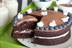 Easy vegan chocolate cake that is rich, velvety and smooth. Perfectly moist layer cake with a whipped coconut cream center and a rich chocolate frosting.