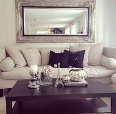 A large wall mirror in the living room would help radiate the light from the sliding door.