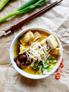 autumnal noodle bowls: noodles in a coconut, pumpkin, ginger & turmeric broth, topped with seared mushrooms, crunchy tofu, scallions and bean sprouts