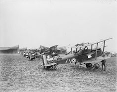 "IWM caption: ""Royal Aircraft Factory S.E.5As of No. 32 Squadron at Humieres aerodrome near St. Pol, 6 April 1918. The leader's engine is running and an air mechanic is seen holding the fuselage down to prevent the slip stream for the airscrew from lifting the tail."" Source: IWM (Q 12009)  Note: The censor has removed the serials, and other details, from the photo."