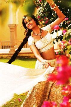 Beautiful India simple country girl, gopi dancing long swinging braid