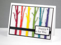 colorful card with a line of die cut birch trees in bright colors...luv the look!!