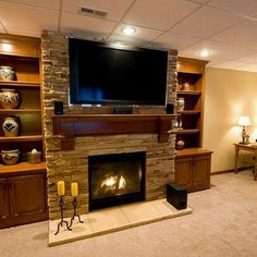 Basement tv room ideas indoor stone veneer basement above fireplace design ideas pictures remodel and decor Tv Over Fireplace, Home, Home Fireplace, Family Room Design, Home Remodeling, Fireplace Design, New Homes, Indoor Fireplace, Basement Tv Rooms