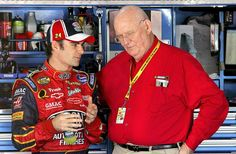 Jeff Gordon talks to Benny Parsons in the garage during practice for the Bank of America 500 on Oct. 13, 2006 at Charlotte Motor Speedway.
