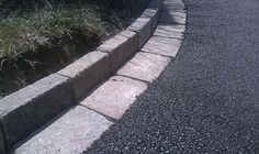 driveway with asphalt and brick | Decorative Edging on Asphalt Driveways Serves Important Purpose