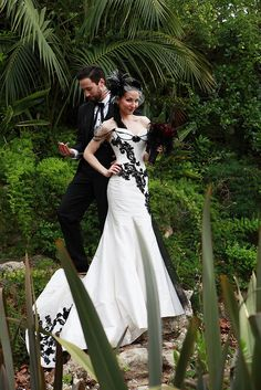 Great dress.  Love the shoulder beaded accents and the bouquet is a deep burgundy with black feathers.  Very chic.