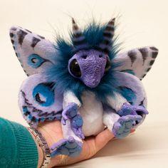 Lilac Mof by Magweno.deviantart.com on @deviantART ...Weird ass lil' critter, cute too though :)