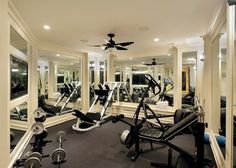 I love it when home gyms have mirrors on every wall. It really helps to give them the atmosphere of a real gym #Mirrors #Gym