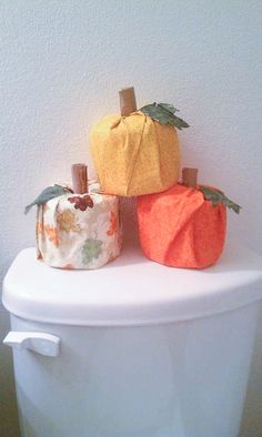 Make toilet paper pumpkins with fabric or tissue paper! Glue on a leaf and put cardboard from another toilet paper roll in the center.