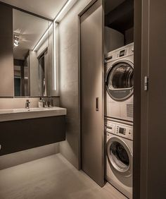 Small Apartment Interior Design: Working With Just 40 Square Meter Square Feet). Next to the sink, designers have also managed to hide a washer and dryer behind a clever sliding door for the ultimate in convenience. Laundry Room Wall Decor, Laundry Room Design, Laundry In Bathroom, Small Bathroom, Bathroom Faucets, Bathroom Ideas, Bathroom Cabinets, Small Laundry, Bathroom Mirrors