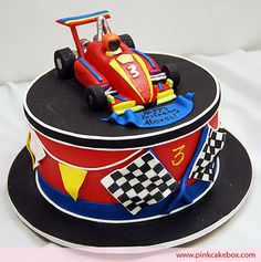 My brother loved matchbox cars as a kid and I'm sure he would have loved this race car cake we created for a 3 year old. The cake flavors included Fondant, Race Car Cakes, Racing Cake, F1 Racing, Pastries Images, Party Fiesta, First Birthday Cakes, Car Birthday, Different Cakes