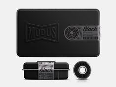 concept would use a stamped tin box painted mat black with wrapping label...