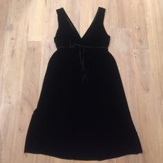 "Vince Black Velvet V-Neck Dress Size Small Gorgeous Black V-neck and back Vince dress. Wore this once and unfortunately it's too big on me now. It has elastic at the inside of the empire waist to give it some shape and a grosgrain ribbon tie. It falls about mid-calf on me, but I'm 5'2"". Vince Dresses"