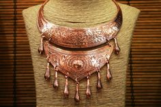 """Copper Nomad Hill Tribe Necklace Miao Hmong Ethnic by CultureCross """"This is a traditional Miao Hmong hill tribe style. Traditionally worn for good luck and protection.  This type of necklace is usually silver. It is very rare to find one that is copper. Etched floral designs, representing the energy of nature. The Hmong and Miao (the Hmong of China) believe that spirits live in all things, especially in nature."""" $44.25 USD Amazing!"""