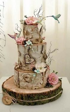 A pair of whimsical hummingbirds bring this lovely woodland wedding cake to life!