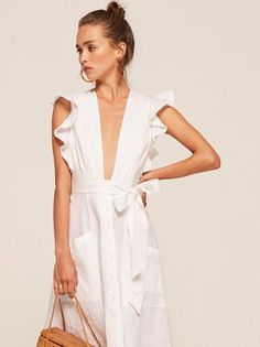 The ruffled collection. This is an open front, midi length dress with a ruffle edged sleeves, pockets and a belted waist.