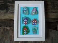 painted sea glass beach huts in a wooden frame