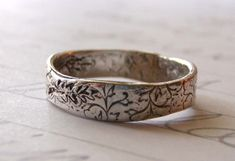 rustic wedding band . recycled silver wedding band with feather . custom jewelry by peacesofindigo