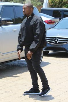 Kanye West wearing Adidas Ultra Boost Sneakers and Acne Studios Ace Used Cash Slim-Fit Jeans