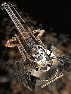 somewhere around the house i have some pieces of this lying around…. Guitar Art, Cool Guitar, Steampunk Guitar, Punk Genres, Sculpture Art, Sculptures, Hipster Art, Concept Weapons, Junk Art