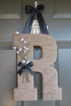 Monogram Door Hanger.  Twine or sisal wrapped around a wreath, letter or frame is a great idea for your next DIY craft.  Holiday door decoration inspiration.