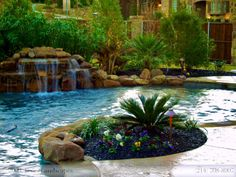 Pool with nice waterfall - Texas Landscapes.com
