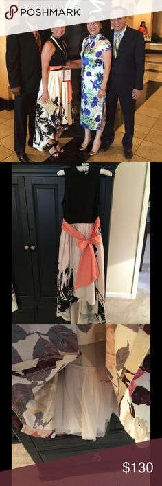 Anthropologie Dress 👗 Beautiful high-low dress. Colors are cream, peach and black. This dress is amazing!  Size 8. (I'm a size 2-4... I loved this dress so much that I purchased and extra padded bra and tied the sash tight!!  So ladies at sizes 2 - 8 can wear the dress! 😉) Anthropologie Dresses High Low