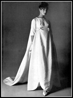 Model in white faille evening gown by Louis Feraud, photo by Pottier, 1960 Evening Gowns With Sleeves, White Evening Gowns, Classic Wedding Gowns, Wedding Styles, 1969 Fashion, Woman Fashion, Vintage Outfits, Vintage Fashion, Vintage Clothing