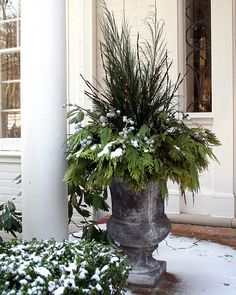 use your Christmas tree trimmings and sticks to decorate a beautiful Christmas urn