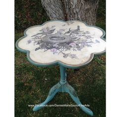 """Little side table painted in Annie Sloan """"Provence"""" and """"Old White"""". Vintage graphic from """"The Graphics Fairy"""" customized and added to top, flowers painted pink and Annie Sloan """"Craqueleur"""" added over top. Clear wax, dark wax and gilding wax completes the look."""