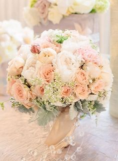 Bridal bouquet inspiration.  Love the peach roses and lambs ear with hints of ivory, babies breath (or small daisyish flower) and pops of maroon.