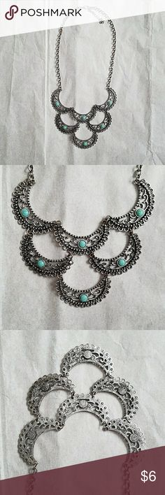 "Metal and turquoise color stone statement necklace Maurice's statement necklace with turquoise colored stones. Necklace sits below collar bone in the shortest setting, 10.5"". Maurices Jewelry Necklaces"