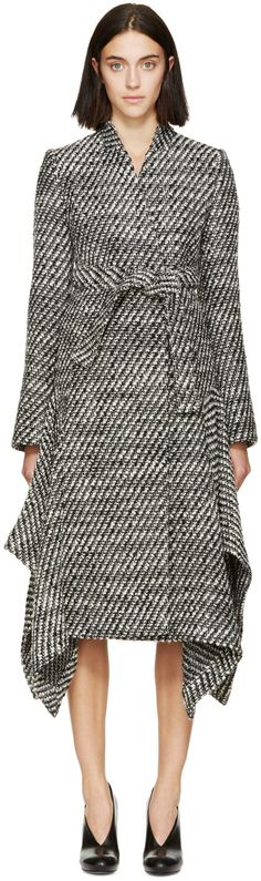 Long sleeve thick-knit wool coat in black and white. Funnel collar. Press-stud closure at front. Self-tie belt at waist. Seam pockets at sides. Partially lined. Tonal stitching.
