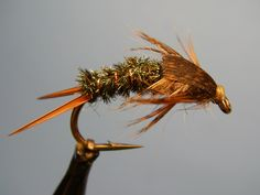 A variation of the Twenty Incher, this stonefly nymph has been altered to handle the large steelhead and salmon found in Michigan Rivers. It borrows elements of the Prince Nymph and Half-back  - tw...