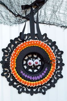I love making Halloween decorations! This monster candy corn wreath is fun, easy and inexpensive with supplies from Dollar Tree's Value Seekers Club. #DTVSC #AD