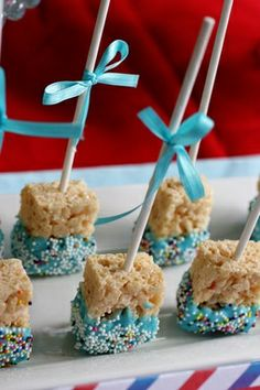Rice Krispie Pops. These would be way easier than Cake Pops. Cute idea for birthday treats for classroom..We actually dipped them like this on the bottom but used pink instead for a girl and added pink marshmallow cream on the top with pink ribbons and a label that said Have a pinkalicious Day. They were so cute!
