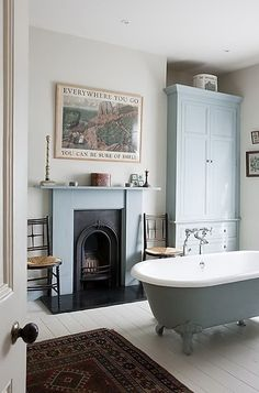 Want white floors in my bathroom with the clawfoot tub Beautiful Bathrooms, Bathroom Fireplace, Bathroom Inspiration, House Interior, Home, Small Bathroom, Small Bathroom Decor, Bathroom Decor, Vintage Bathrooms